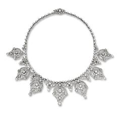 DIAMOND NECKLACE, BOUCHERON Of foliate design, set with seven graduated pendants set with old mine- and circular-cut diamonds together weighing approximately 17.00 carats, mounted in 18 karat white gold, length approximately 430mm, maker's marks, circa 1900s