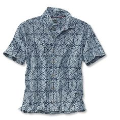 Pair this eye-catching casual blue cotton print camp shirt with your favorite khaki shorts.