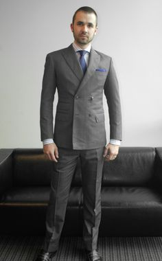 Fitted double breasted suit, by Beckett & Robb.  We love how fitted and short this client designed his suit!