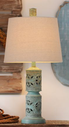 "Finding it hard to decorate for fall in your summer-themed space? We've got the solution. The ""Blue Island Table Lamp"" adds subtle color, intricate detailing and yes that classic coastal decor feel for your themed space."