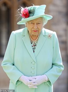 Photos show Her Majesty looking resplendent in green...