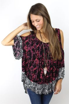 This floral  plaid mixed print top by Free People features jewel-tone inspired hues that we just love for fall. Deep scooped neckline in front  back. Three-quarter bell sleeves with cutouts at shoulders. Cascading high to low hem. Relaxed flowy fit. Pair with dark denim beachy waves  booties.f323u088