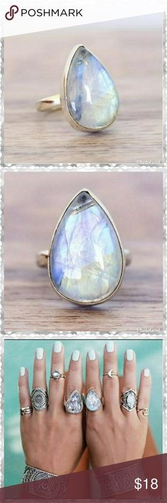 Pear shaped Sterling Silver Moonstone ring The large pear shaped moonstone really sparkles. The manufacturer states that the ring is Sterling Silver. However it IS NOT stamped on the inside of the ring. This is a nice chunky,  heavy ring. New in manufacturers package. Jewelry Rings