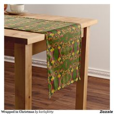 Wrapped in Christmas Medium Table Runner    Fractal generated gift boxes in red wrapping with gold ribbons and holly on a green background.