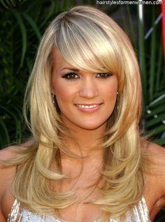 Carrie Underwood with long layers and side-swept bangs.