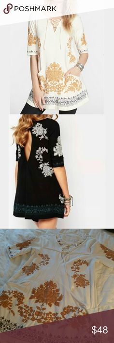 Free people talia embroidered tunic dress Pullover lace up front keyhole back Cotton, with embroidering throughout. Wear as tunic or mini dress  2 very faint marks on front cannot see unless u search for them up close.(pic 4)  Size small White combo Free People Tops Tunics
