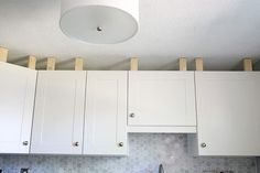 How to Install a Crown Molding to Kitchen Cabinets | JustAGirlAndHerBlog.com                                                                                                                                                      More