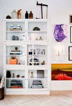 stacked white, glass-front cabinets with collectibles inside / sfgirlbybay