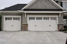 Residential White Carriage Garage Doors with Top Windows - S.- Residential White Carriage Garage Doors with Top Windows – Single and Double Residential White Carriage Garage Doors with Top Windows – Single and Double - Garage Door Trim, White Garage Doors, Single Garage Door, Garage Door Company, Carriage Garage Doors, Garage Door Windows, Garage Door Styles, Garage Exterior, Garage Door Makeover