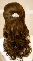 I really like this style. Kinda looks like how I had my hair for senior prom, only fancier.