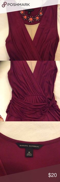 Banana Republic Toga Inspired Party Dress This is a beautiful dark burgundy dress from Banana Republic. It is in excellent condition. It has a faux wrap look with pretty detail in the front. It is a size Medium and fits very nicely. It's approximately knee length. Banana Republic Dresses