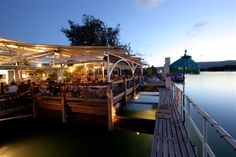 My boyfriend and his family ate here and fed fish of the deck while in Port Douglas, North Queensland, Australia...it was Fantastic!!!