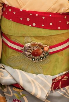 set B. Maiko and geisha obidomes. [ Obidome are small brooches worn threaded onto the obijime, making a charming decoration on the front of the obi.] 2012, Kyoto, Japan. Photography by Stephane Barbery