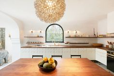 Love the mix of texture and materials in this kitchen/dining area at jewelry designer Irene Neuwirth's store in LA. (Designed by Commune Design) #communedesign #ireneneuwirth