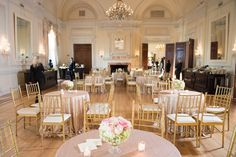 Golden Indoor Cocktail Hour Décor    Photography: Brett Matthews Photography   Read More:  http://www.insideweddings.com/weddings/regal-outdoor-ceremony-ballroom-reception-at-oheka-castle-in-ny/821/