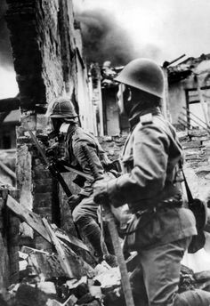 Japanese Marines take cover behind the ruins of a house during the Battle of Shanghai of the Second-Sino-Japanese War. The Battle of Shanghai can be divided into three stages, and eventually involved nearly one million troops. The first stage lasted from 13 August to 22 August 1937, during which the Chinese Army attempted to eradicate Japanese troop presence in downtown Shanghai. The second stage lasted from 23 August to 26 October 1937, during which the Japanese launched amphibious landings…