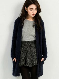 cf862ead2b4 Fluffy Cable Knit Cardigan This Fluffy Cable Knit Cardigan features a  regular fit knitted cardigan made