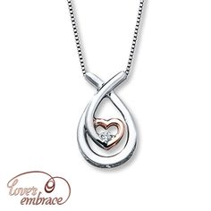 A sparkling diamond rests in a heart of 10K rose gold surrounded by a sweep of sterling silver in this remarkable necklace for her. The pendant is suspended from an 18-inch box chain with a 2-inch extender and secured by a spring ring clasp.  Love's Embrace®. You will always be surrounded by the strength of my love™.