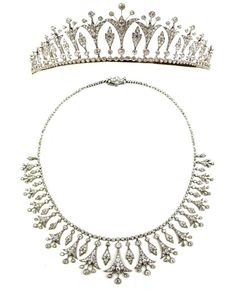 Belle Epoque Diamond Tiara c1905 converting to a necklace.  Designed as a graduated row of stylized trumpet shaped bellflowers, each emanating three collet diamond stamens, foliate cluster drops between, from an articulated line of collet diamonds, all millegrain set.