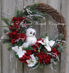 Christmas Wreath, Holiday Wreath, Owl, Woodland, Poinsettia Wreath, Designer Holiday Wreath, Elegant Christmas Wreath Snowy Owl Holiday Wreath. A stunning snowy white feathered Owl sits upon a rustic grapevine frame surrounded by a lush gathering of deep red Hydrangeas, winter-white glittered Poinsettias, frosty silk Canadian Pine boughs, red berry branches and accented by an abundance of icy-crystal branches. A simply beautiful and elegant holiday treasure! Realistic, high-quality silk...