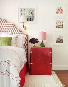 Red details mix with playful patterns in this girl's bedroom - Traditional Home® / Photo: Pieter Estersohn & John Bessler / Design: Celerie Kemble