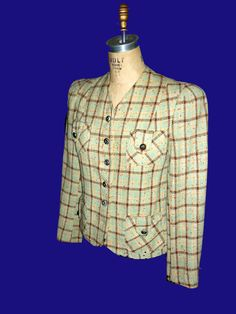 This is a late 1930's woman's jacket. We have a large selection of women's outer jackets, capes, capelets, coats of every period