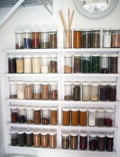 Easy to make spice rack with vinyl moulding! Stores up to 60 jars