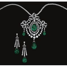 FORMERLY IN THE COLLECTION OF A SPANISH DUCAL FAMILY Important emerald and diamond parure, circa 1900. Comprising a pendant/devant de corsage in the Garland style, composed of three bows millegrain-set with circular and single-cut diamonds, each suspending an emerald drop capped by rose stones, the central swing motif to a double frame of similar diamonds, embellished with a diamond set swag with another emerald drop; with a pair of matching earrings