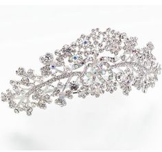Silver Plated Comb Wedding Tiara features silver rhinestones of various sizes. Bridal tiara will add sparkle and shine to the bride's ensemble.  #bridalhairaccessories  #daisydays