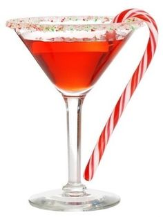 The Candy Cane Cocktail - Christmas Holidays - soda water, half and half, grenadine, white Creme de Cacao, Peppermint Schnapps, SKYY Berry vodka, candy cane.