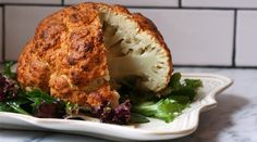 SPICY WHOLE ROASTED CAULIFLOWER Makes 6 servings Start to Finish: 1 hour  Ingredients 1 T   oil 1 head cauliflower 1½ cups plain Greek yogurt 1 lime, zested&juiced 2 T chile powder 1 T cumin 1 tablespoon garlic powder 1 t  curry powder 2 t  kosher salt 1 t  black pepper