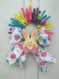 This is a smaller version of a clothespin wreath, it measures only 10.5 inches a round. The wreath is decorated with glitter accented clothespins in