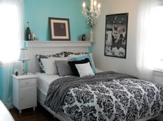A turquoise and black room for a teen girl
