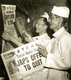 Aug. 10, 1945: Two chefs in a Boston Chinese restaurant cheered news headlines in the Boston Evening Globe announcing the Japanese offer to surrender.