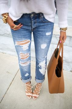 Ripped denims and lace-up beauties.
