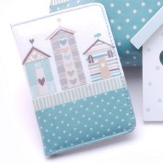 Beach Hut Gisela Graham Shoreline Passport Holder - £6.50.  Oil cloth beach hut passport holder from Gisela Graham.  A perfect accessory for those many travellers amongst you.