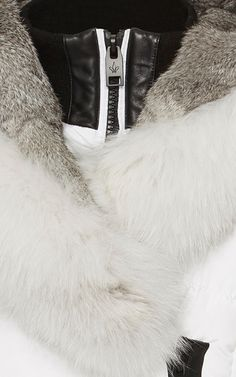 This **Nicole Benisti** jacket features a slim fit and a fur trimmed shawl collar.