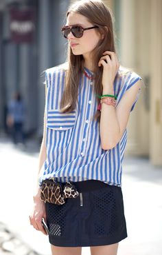 The striped shirt with those ripped of sleeves, paired with a straight skirt looks so damn good.