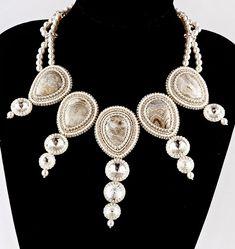 Galina Bursuk is beadwork artist from Ukraine. She makes beautiful beadwork with wonderful colours and original design.