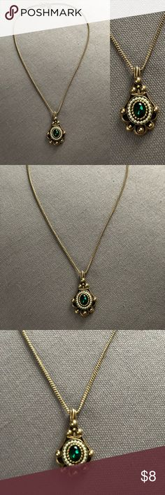 Art Deco Avon Necklace Costume Jewelry Vintage Avon Art Deco necklace! Gold metal with emerald style jewel, would be great as a statement piece with a simple tee! Avon Jewelry Necklaces