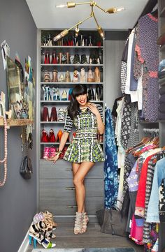 i like the mirror, hooks and inspiration photos on the wall.... I want this closet ;)