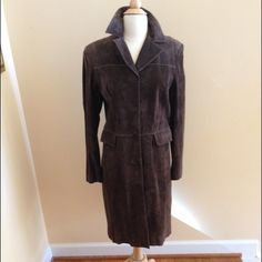 """Full Length Brown Suede Coat from Ann Taylor Soft and Supple Rich Chocolate Brown Suede Coat Fully Lined with Five Button Closure and Two Flap Pockets. Contrast stitching all around coat and deep vent in back for ease of walking. Like new condition! 28"""" from under the armpit. 231/4"""" sleeve length. Ann Taylor Jackets & Coats"""