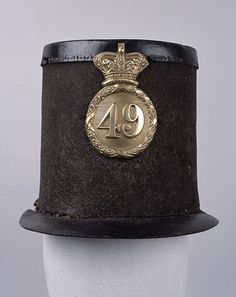Other ranks' shako, 1844-55 pattern, 49th (Princess Charlotte of Wales's or Hertfordshire) Regiment.The 1844-55 pattern shako is usually referred to as the 'Albert' shako after the Prince Consort who, as with so many things, is believed to have influenced its design. With its peaks both fore and aft the style is Austrian. One of the ugliest headdresses ever inflicted on the British Army, it was also unpopular for practical reasons, a