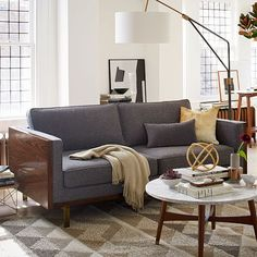 Open and shut case. Encased in a rosewood-finished wood frame and perched on metal legs, the Wyatt Sofa marries a modern design with cozy comfort. Welted seams along the cushions give it a tailored look.