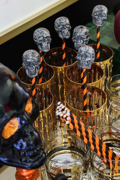 Make these DIY skull drink stirrers in five minutes or less! An easy halloween craft that is perfect for a Halloween party!