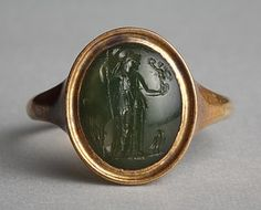 Athena with Nike, an owl and ears of corn. Graeco-Roman ringstone, 30 BC-200. Plasma, gold (modern gold ring). 1,2 x 1,0 cm.