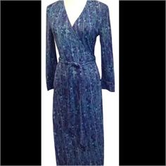 Blue and green DVF wrap dress. Blue and green wrap dress. 3/4 sleeve. Perfect condition. The tag is a little detached still perfect condition. Make me an offer, no low balling. Diane von Furstenberg Dresses Midi