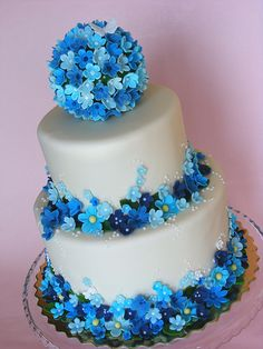 Blue Flowers Cake....i'd do away withthe ball on top and just put a mound of flowers