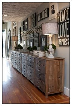 loving the row of cabinets and the eclectic-ness of the signs and mirrors on wall Decorating Long Hallway, Home Interior, Interior Design, Interior Ideas, Interior Office, Modern Interior, Interior Architecture, Style Deco, Home And Deco