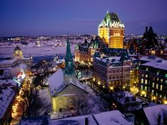 Photo: Night view of city skyline    The century-old Fairmont Le Château Frontenac hotel overlooks the St. Lawrence River in Quebec.    Photograph by Richard T. Nowitz, National Geographic